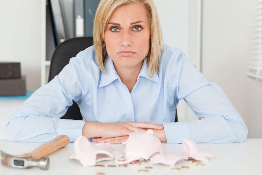 Sad woman shattered piggy bank